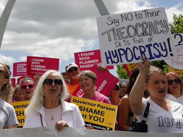 Abortion-rights supporters take part in a protest in St. Louis. The Planned Parenthood clinic in the area will stay open while its legal fight with the state continues.