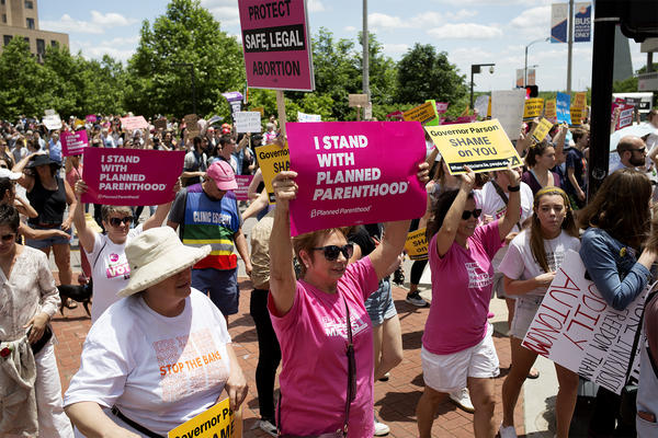 Abortion rights activists on Thursday gathered near the Gateway Arch to protest the potential closure of Missouri's only abortion provider. They marched to the Wainwright State Office Building and decried the state's efforts to limit access to abortion.