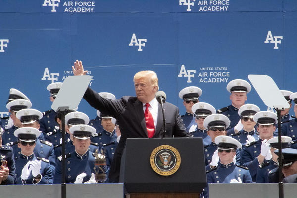 President Donald Trump waves to the crowd as he begins his address.