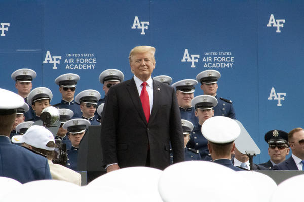 President Donald Trump stands in front of cadets at the commencement ceremony.