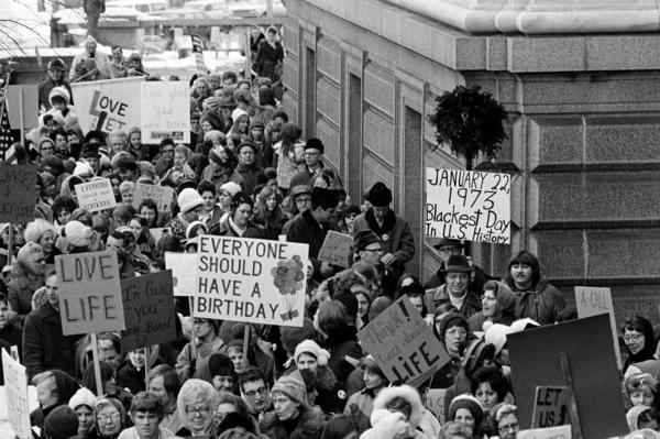 "On Jan. 22, 1973, the day of the court's decision, an estimated 5,000 women and men formed a ""ring of life"" around the Minnesota Capitol building and marched in protest of the ruling that ""abortion is completely a private matter to be decided by mother and doctor in the first three months of pregnancy."""