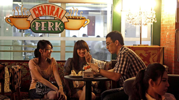 Customers chat at a Beijing cafe modeled after the Central Perk cafe in the hit American sitcom <em>Friends</em>, in<em> </em>2010. Nearly a decade after the series ended, the popularity of <em>Friends</em> continues among young Chinese, who use the show as a language-learning tool and enjoy its depiction of young Americans.