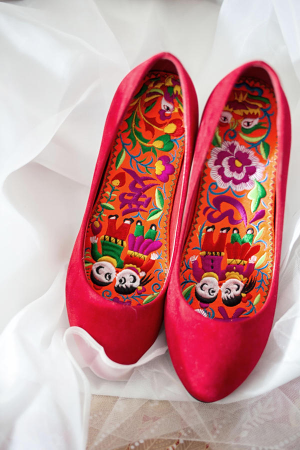 Wang's mother made special insoles for her daughter's lucky wedding shoes. The shoes were hidden for Wei to find and put on Wang's feet as part of the games leading up to the wedding.