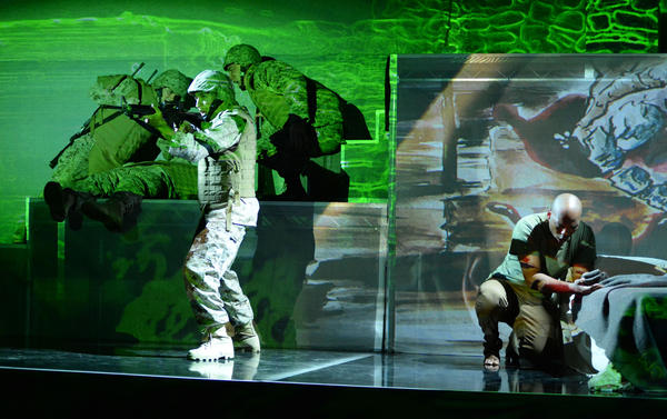 Actors onstage during a performance of <em>Fallujah</em>. The Long Beach Opera production is based on the combat experiences of a U.S. Marine in Iraq, and was co-written with an Iraqi-American.