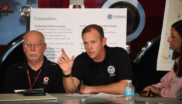 Administrator Brock Long of FEMA (center) speaks during a firehouse briefing on Hurricane Harvey in Corpus Christi, Texas, on Tuesday.