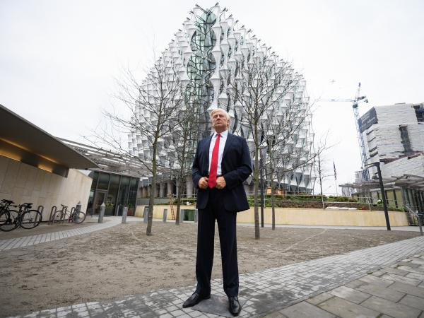 """A model of President Trump from the Madame Tussauds waxwork museum was brought Friday to the new U.S. Embassy in London's Wandsworth borough. """"Trump cancelled his visit so we stepped in!"""" Madame Tussauds tweeted."""