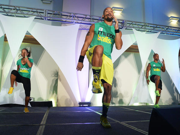 Shaun T attends the Sweat USA America's All-Star Fitness Festival at the Miami Beach Convention Center in 2013. At some live events, thousands of people turn out to work out with the fitness superstar.