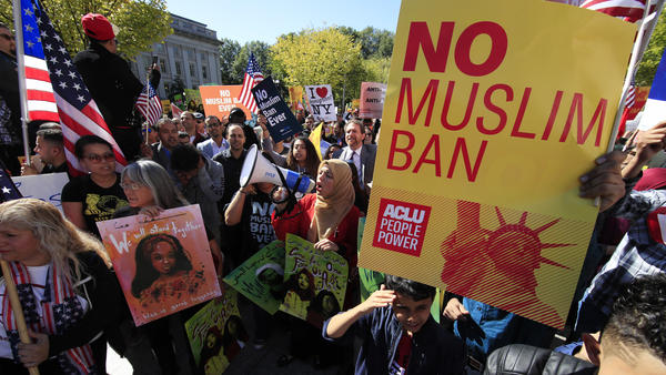 Demonstrators rally in Washington, D.C., last fall against the Trump administration's travel ban, which was argued before the Supreme Court Wednesday.