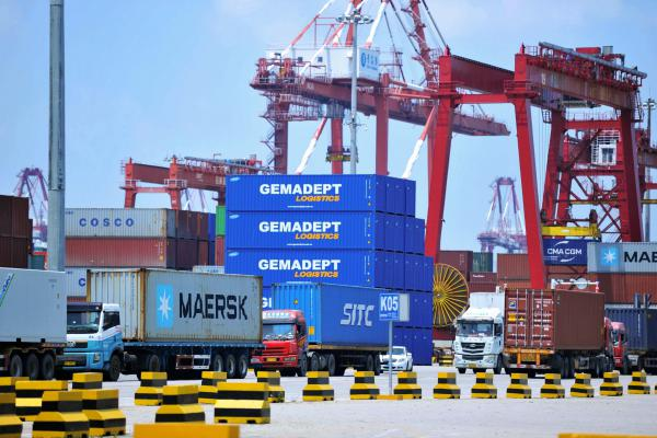 Containers are transferred at a port in Qingdao in China's eastern Shandong province last week. The Trump administration announced plans to levy tariffs on another $200 billion of Chinese goods as trade tensions escalate.