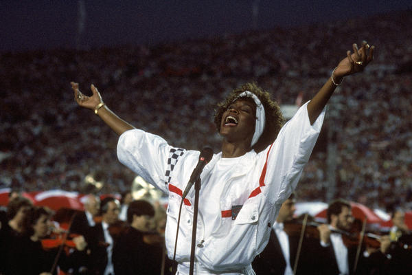 """At Florida's Tampa Stadium in 1991, Whitney Houston delivered an iconic performance of """"The Star-Spangled Banner"""" to kick off Super Bowl XXV."""