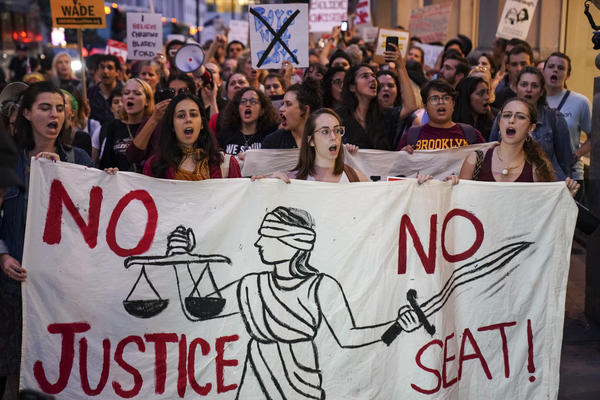 Protesters march through Midtown Manhattan on Monday as they rally against Supreme Court nominee Judge Brett Kavanaugh.