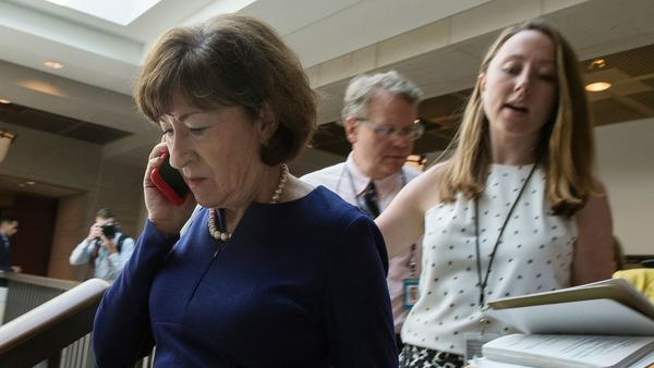 Sen. Susan Collins, R-Maine, talks on a phone while walking to a room on Capitol Hill to read the report on the supplemental FBI investigation into Supreme Court nominee Judge Brett Kavanaugh.