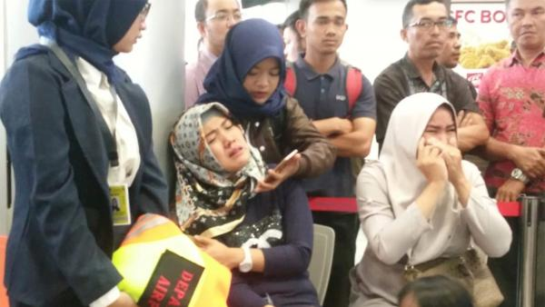 Relatives of passengers of Lion Air flight JT610 that crashed into the sea cry at the airport on Monday in Pangkal Pinang, Indonesia, where the plane was bound.