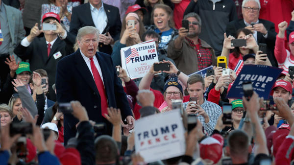 """President Donald Trump, photographed on October 27, in Murphysboro, Illinois. The President was criticized by the artist Pharrell for using his hit composition """"Happy"""" during a rally held the same day as a massacre that in a Pittsburgh synagogue."""