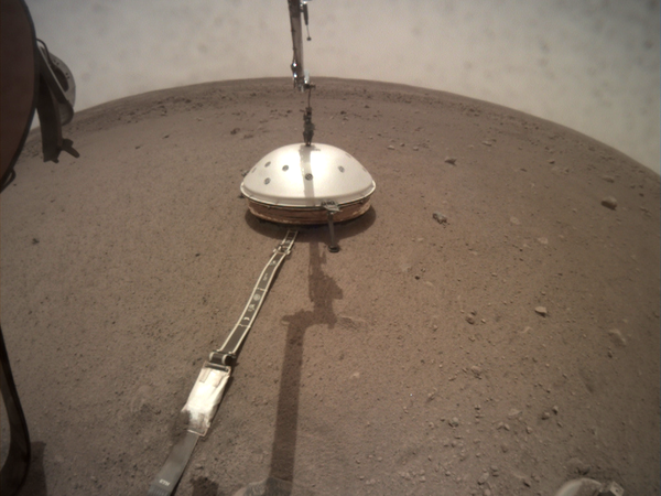 InSight seismometer with protectiive wind cover deployed on Mars.