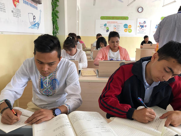 Uighurs at a detention facility in Kashgar study Mandarin. They also study Chinese law and a variety of vocational skills. NPR visited the facility as part of a Chinese government-sponsored tour.
