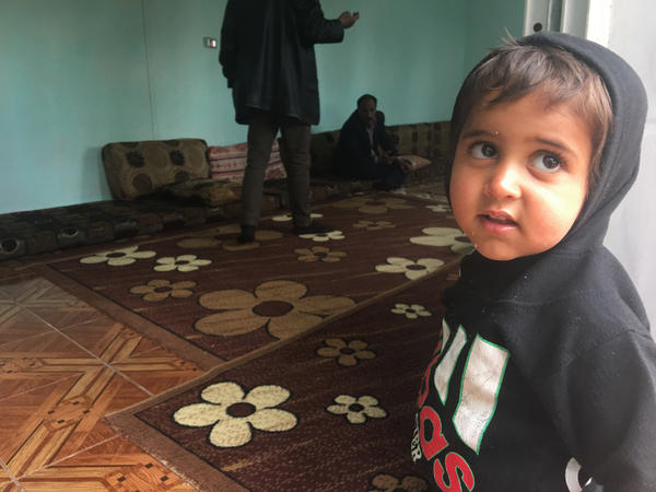 Ibrahim, 2, in northeastern Syria a few hours after his freed Yazidi mother returned to Iraq without him. Ibrahim's father was an ISIS fighter. Although his mother wanted to take him home, the Yazidis do not allow children of ISIS fathers to live with the community. Iraqi law considers the children Muslim rather than Yazidi.
