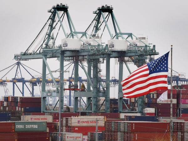 Chinese shipping containers are stored at the Port of Los Angeles in Long Beach, Calif. Americans, in bigger numbers than ever, like trade. But they also believe China doesn't play fair in trade.