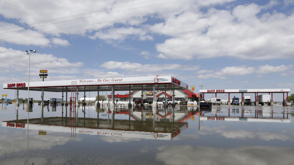 A Sapp Bros. gas station in Percival, Iowa, stands in floodwaters from the Missouri River on May 10. Lawmakers have reached a deal on disaster aid that they say President Trump will sign.
