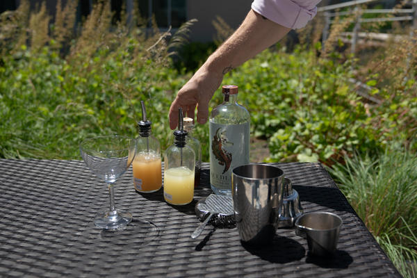 Derek Brown begins making an alcohol-free cocktail.