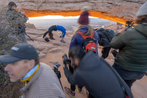 A young woman struck a yoga pose in front of Mesa Arch at Canyonlands National Park in southern Utah on May 4, 2019.