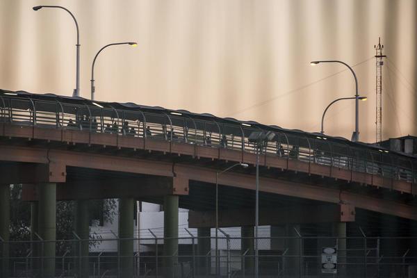 Pedestrians cross the international bridge that connects Ciudad Juarez, Mexico, and El Paso.