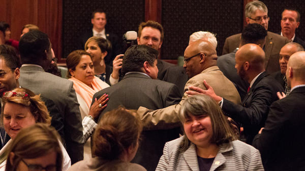 Democratic legisaltors crowded around Gov. J.B. Pritzker after delivering on a range of his agenda items, from legalizing marijuana to pasing a statewide infrastructure plan.