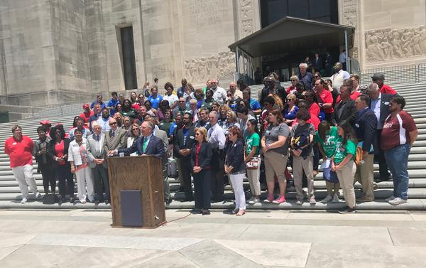Governor John Bel Edwards, backed by leaders in the education community, defended his plan for K-12 funding at an education rally in May.