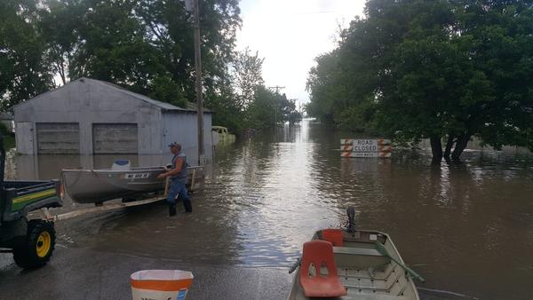 Flood waters rise in Levasy, Missouri, after a levee breached Saturday morning.