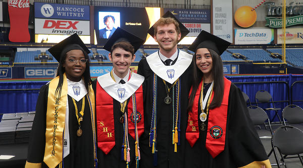 From left, Lakewood High School traditional studies Valedictorian Shadine Henry stands with Center for Advanced Technologies Salutatorian Stefan Mason, CAT Valedictorian Nathan Hamilton, and Lakewood High traditional studies salutatorian Camila Romero