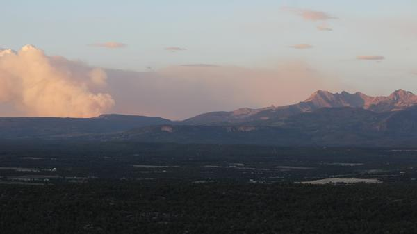 Smoke from the 416 Fire drifts over the La Plata Mountains on June 28, 2018.