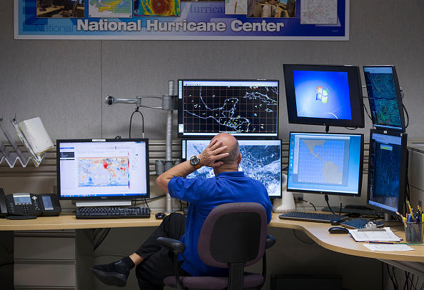 MIAMI, FLORIDA - MAY 31: Lixion Avila, Senior Hurricane Specialist, works at the NOAA NWS National Hurricane Center as the media is given a tour before the start of the Atlantic hurricane season.