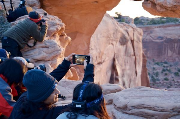 Around 50 tourists and photographers were huddled near Mesa Arch to catch a glimpse of the sunrise on Saturday, May 4, 2019.
