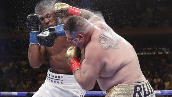 Andy Ruiz Jr. (right) and Anthony Joshua exchange punches during the heavyweight championship match Saturday. Ruiz won in the seventh round.