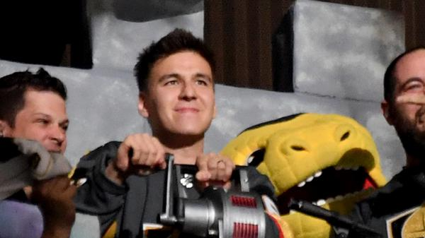 Professional sports gambler and <em>Jeopardy!</em> champion James Holzhauer sounds a siren before the start of an NHL playoff game between the San Jose Sharks and the Vegas Golden Knights in April.