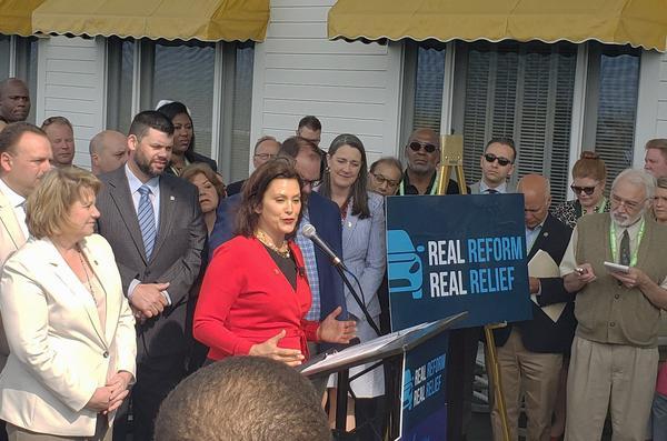 Gov. Gretchen Whitmer signed new auto insurance legislation that she says will cut rates.