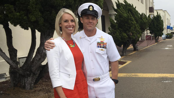 Navy Special Operations Chief Edward Gallagher leaves a military courtroom on Naval Base San Diego with his wife, Andrea Gallagher, on May 30. Accused of war crimes, he was released from custody after a military judge cited interference by prosecutors.