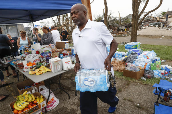 Local volunteers organize relief support for victims of a tornado system that passed through the area, destroying homes and damaging public utilities. Tens of thousands of residents were still without power or water Wednesday.