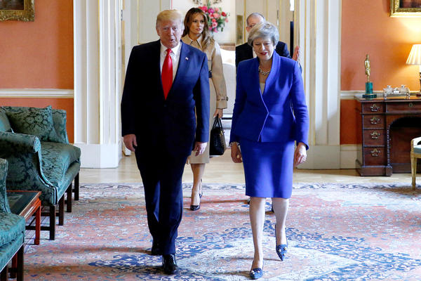 President Trump and British Prime Minister Theresa May tour 10 Downing Street on the second day of his state visit to the United Kingdom on Tuesday.