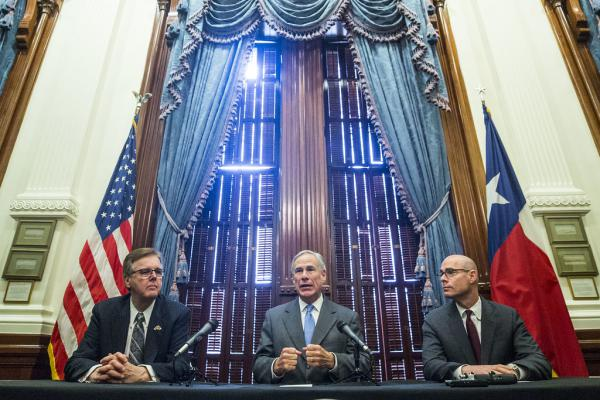 Lt. Gov. Dan Patrick, Gov. Greg Abbott and House Speaker Dennis Bonnen hold a press conference last month to discuss property taxes, one of their legislative priorities. Advocates say they are disappointed health care was not also a priority this session.