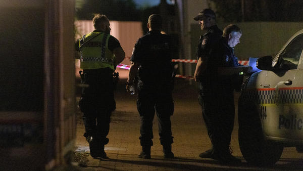 Police block off an area along a street after a shooting in Darwin, Australia, on Tuesday. Authorities said a lone gunman killed at least four people and wounded one more.
