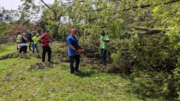 Thousands of volunteers worked across Dayton area neighborhoods over the weekend to clean up damage from the Memorial Day tornado outbreak.