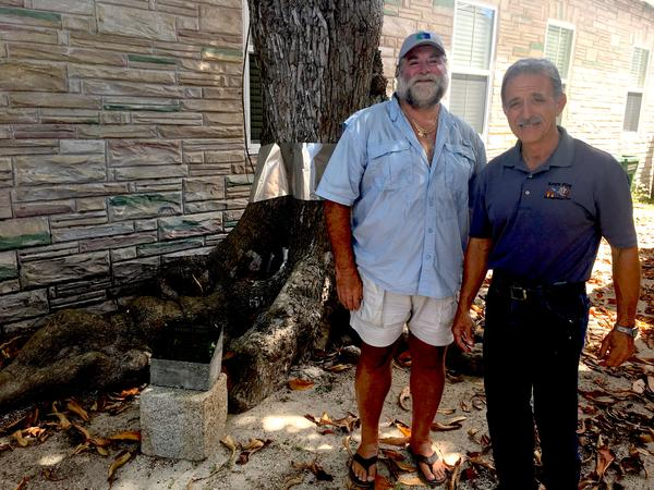 John Gallagher, left, and Alex Vega, right, are among the retired firefighters who run the Key West Firehouse Museum.