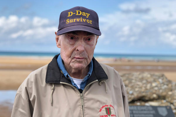 Ray Lambert, 98, stands on Omaha Beach, where 75 years ago, he fought during the D-Day invasion.