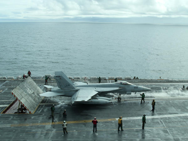 An F/A-18 Super Hornet getting ready to fly off the USS Theodore Roosevelt in the Gulf of Alaska.