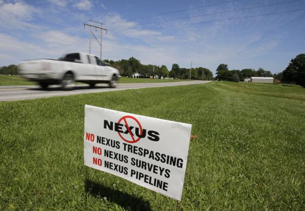 A truck passes a sign against the NEXUS pipeline on the property of Kathy Cikotte, in Berlin Heights, Ohio, on July 16, 2015.