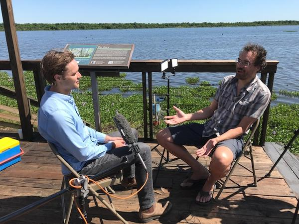 WWNO's Travis Lux, left, speaks with Tulane's Torbjorn Tornqvist, right, about subsidence.