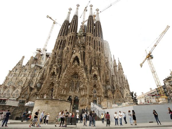 The unfinished Sagrada Familia basilica was granted a building permit on Friday after going without one for 137 years. The church's foundation and the city of Barcelona came to a historic agreement, with the foundation agreeing to pay the city millions of dollars for the completion and preservation of the basilica.