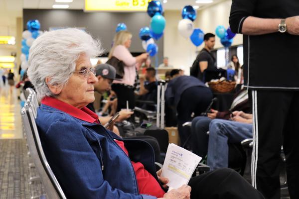A passenger waits for a Delta flight at the John Glenn Columbus International Airport on Friday, June 7, 2019.