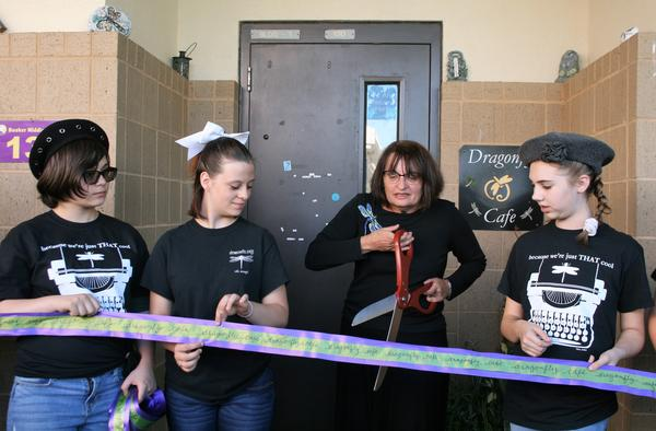 Booker Middle School students and creative writing teacher Joanna Fox, at a ribbon cutting ceremony for the school's updated Dragonfly Cafe.